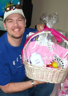 Rick holding up his Baby Shower Gift Basket he made for his friend Jennifer
